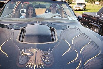 Me and Kim in the summer of 2000 in my old Trans Am
